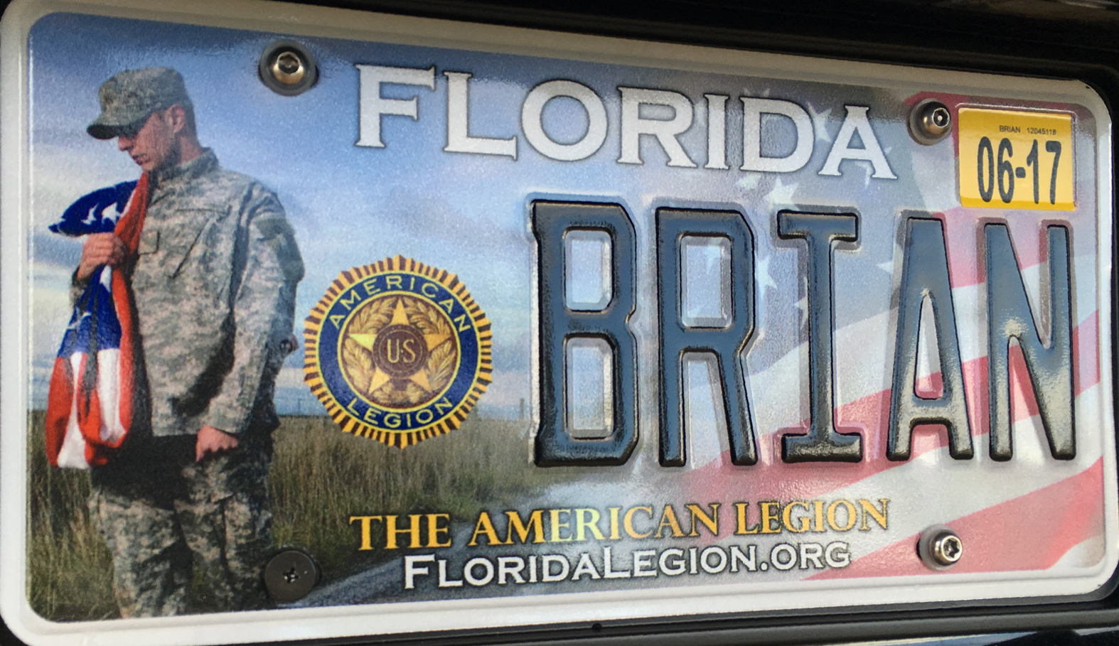 an iPhone photograph of a American Legion license plate in Florida